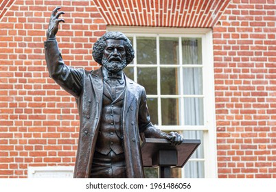 04-16-2021 Easton, MD, USA: Statue of the famous reformist abolitionist African American leader Frederick Douglass, in front of the Talbot County Courthouse, where he was once kept as a prisoner.