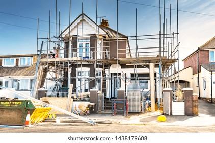 04.18.2018. Kent, UK. Workmen erectiing scaffolding around a house