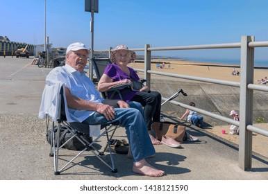 04.19.2018 Kent UK. Elderly couple enjoying the sunshine Minnis bay, Kent