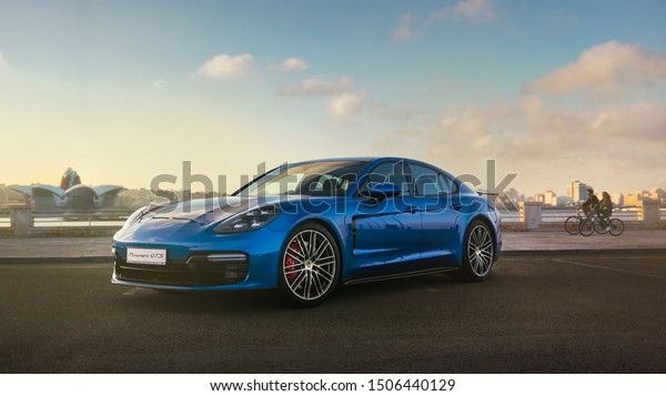 04222019 Blue Porsche Panamera Background Wallpaper Stock