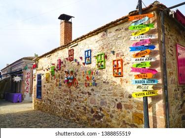 04/24/2019- Cunda, Ayvalik, Turkey.  Fancy wall view with signs on the island.