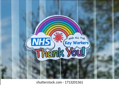 04/24/2020 Portsmouth, Hampshire, UK A rainbow in a houses window to thank the NHS and key workers during the Coronavirus or Covid-19 Isolation