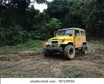 05 Jan 2018 , Jerantut, Malaysia, Yellow Toyota Land Cruiser FJ40 with off road modification park after flood crossing in Jerantut , Pahang during Monsoon.