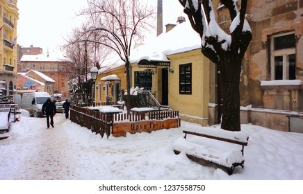 05.01.2016. BELGRADE SERBIA Famous bohemian district Skadarlija street covered by snow, in winter time, people passing by with old colorful houses and restaurants