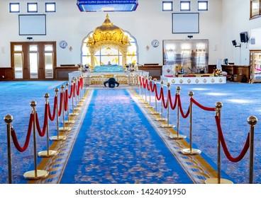 05.01.2018, Gravesend, Kent,UK. Male worshiper inside Guru Nanak DarbarGurdwara, the magnificent sikh temple ( Gurdwara )  in Gravesend Kent