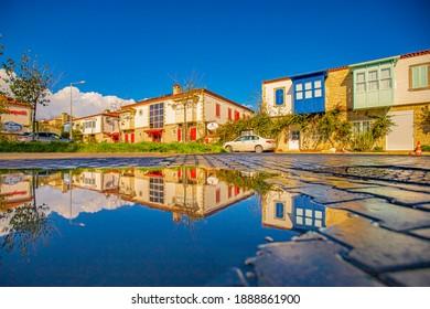 Alaçatı ,Çeşme-İzmir : 05-01-2021 colorful stone houses and reflections