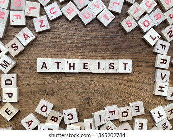 05.04.2019 Parma, Italy: Atheist - made with letters on the wooden table. Concept