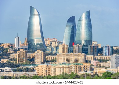05/05/2019 Baku, Azerbaijan, Panoramic view of Baku city and image of Flame Towers in the middle of old buildings near the Caspian Sea coast
