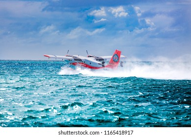 05.06.2018 - Ari Atoll, Maldives: Exotic scene with seaplane on Maldives sea landing. Vacation or holiday in Maldives concept background