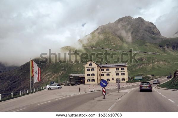05-07-2018 Austria. Road to mountain near traditional mountain house