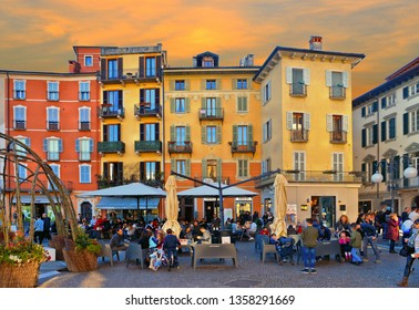 05.08.2018. Glimpses of the historical center of Intra with people old buildings and restaurants in background , Lake Maggiore , Verbania , Piedmont , Italy