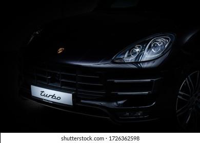 05.08.2020 Vilnius, Lithuania. Porsche Macan Turbo front shot in garage with studio equipment