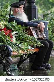 05.09.2012, Moscow, Russia. Celebration of the Victory Day in Moscow. Veteran of the Second World War close up. Sailor with an accordion sitting on the bench in the park.
