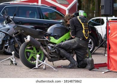05-09-2020 Riga, Latvia Serious young man repairing his motorcycle.