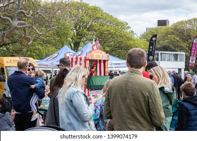 05/12/19 Portsmouth, Hampshire, UK a crowd of families gather round to watch a traditional punch and Judy puppet show