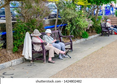05.22.2018 Eastbourne, Sussex, UK. elderly ladies sleeping on a bench Eastbourne promonade