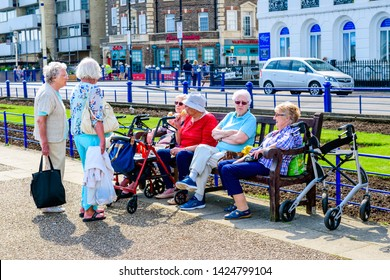 05.22.2018 Eastbourne, Sussex, UK. Group of senior ladies gathering for a chat. Eastbourne promenade,