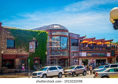 05-26-2018 Stillwater USA - Eskimoo Joes resturant and bar under construction with people standing out front and eating on balcony near Oklahoma State University on bright sunny day