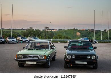 05.28.2016 Moscow region , Yakhroma. VAG festival automotive, retro Audi B1 and Volkswagen Golf on sunset sky background