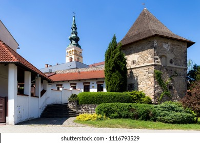 06 May 2018, Novy Jicin, Czech Republic. Old turret and Church of the Assumption of the Virgin Mary
