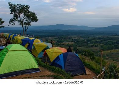 Phetchabun, Thailand - January 06, 2019: The Morning scenery including camping tents on Khao Takhian Ngo Mountain at KhaoKho in Phetchabun, Thailand.
