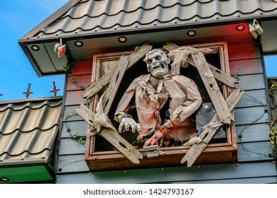 06.03.2018. Rochester, Kent, UK. Frankenstein type monster on top of a fairground haunted house