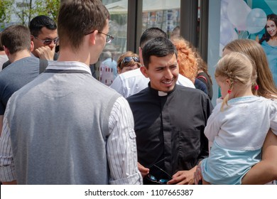 06.06.18 Vinnitsa, Ukraine. Mexican priest walks and talks to people on the street in the middle of the day, Christian