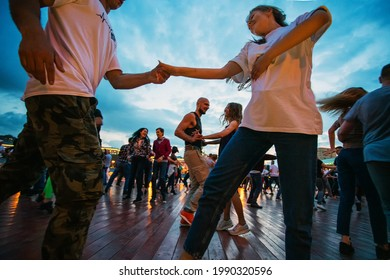 06-12-2021  Moscow russia .  Dancing dancing in moscow gorky park. Outdoors.In Russia, there is a sharp increase in the number of diseases Covid-19, but the restrictions come from tomorrow