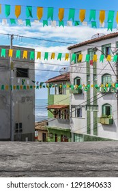 Ilhéus/Bahia/Brazil - 06/15/2014: Street in Ilhéus, Bahia, decorated with green and yellow flags for Saint John's Party, featuring costumes, traditional music and dance, typical foods and drinks.