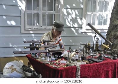 06/22/2013- Cihangir, Beyoglu, Istanbul, Turkey.Antique objects seller on the street in Cukurcuma.