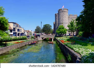 06.25.2018, Canterbury, Kent, UK. Punting on the great stour with westgate towers in the background, Canterbury