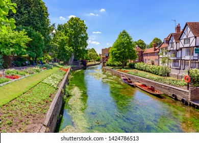 06.25.2018, Canterbury, Kent, UK. punts moored on the great stour river in front of timber framed houses of westgate grove Canterbury