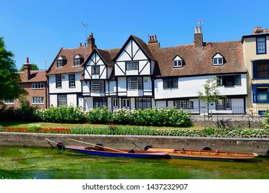 06.25.2018,Kent, UK. punts moored on the great stour river in front of timber framed houses of westgate grove Canterbury