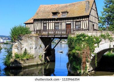 06-27-2018 Vernon France. Old timbered water mill over the Seine, Vernon, Normandy France