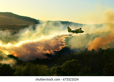 06th July 2017 - SPOLETO , PERUGIA, ITALY: firemen on Italian canadair extinguisher fighting flames in forest on 6th July 2017