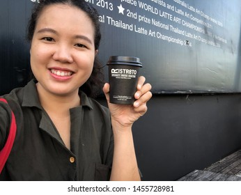 07 Sep 2018; Chiangmai Thailand: Handed Hot Coffee Latte Cup at Ristr8to Cafe Coffee Shop.