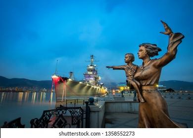 "07.03.2019-Cruiser ""Mikhail Kutuzov"" & Monument ""Sailor's Wife"". It represents the wives and mothers of Novorossiysk, waiting for their sailors. Novorossiysk, Krasnodar Krai, Russia"