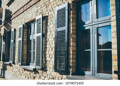 07.05.2021 Riga, latvia, brick building with rectangular black wooden shuttered windows