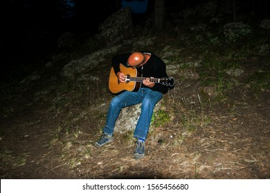 07-07-2007 – 08:14:02, one of the adventurers form the group gave the sound of music at night in deep forest at Pike-National-park, Denver, Colorado, USA
