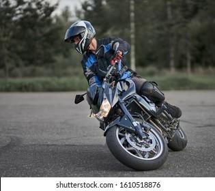 07-08-2019 Riga, Latvia Man riding a motorcycle on the road. Motorcycle rider. Biker. Black motorcycle.