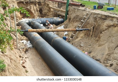 07/31/2018 Minsk, Belarus. Construction work. Workers. Pipe laying. Repair of communications.
