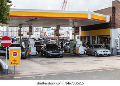 07/31/2019 Portsmouth, Hampshire,UK drivers filling up with fuel at a British shell petrol station with cars on the forecourt