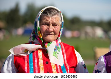 08 29 2020 Belarus, Lyakhovichi. City festival. Old Slavic woman in national dress. Russian granny in a scarf.