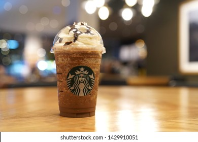 08 June 2019; Bangkok Thailand: Starbucks Mocha Frappuccino Cup with Whipping Cream at Starbucks Cafe Coffee Shop
