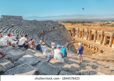 08 September 2020, Pamukkale, Turkey: The guide tells a group of tourists about ancient Greek drama and tragedy and mythology in an ancient amphitheater in the city of Hierapolis in modern Turkey.