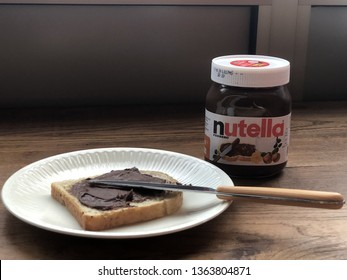 08.04.2019 Parma, Italy: Bread toast with nutella and nutella jar
