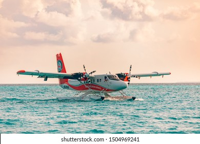 08.09.2019 - Ari Atoll, Maldives: Exotic scene with seaplane on Maldives sea landing. Seaplane taxi on sunset sea before takeoff. Vacation or holiday in Maldives concept background. Air transportation