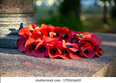 08/09/2020 Portsmouth, Hampshire, UK A red poppy wreath laid on a war memorial in remembrance of war dead