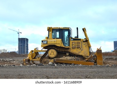08.11.2019 Minsk, Belarus: Track-type bulldozer CATERPILLAR D6T at construction site. Earth-moving equipment background