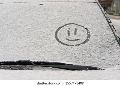 08/11/2019 Russia. St. Petersburg. Smiling emoticon on a car windshield. The concept of polite and cheerful driving.